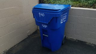 blue curbside recycling bin