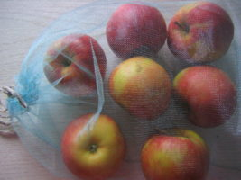 Apples in aproduce bag
