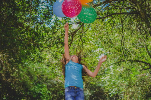 A child playing with balloons