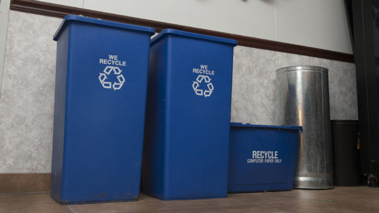 Blue Recyling bins next to a crate